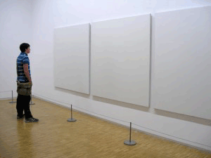 Image of man looking at blank pictures