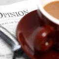 Imagen de periódico y café
