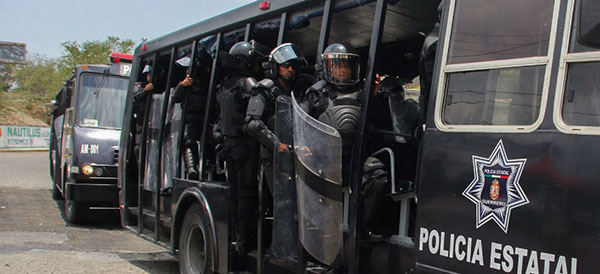 """Heavy-handed police tactics"" used against Ayotzinapa students in 2011"